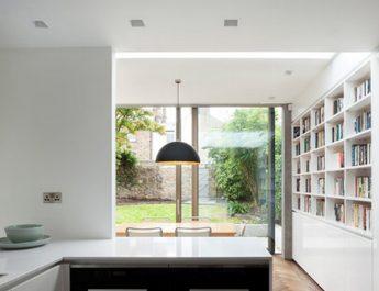 Beautiful Glazed House Feels Like a Garden's Extension